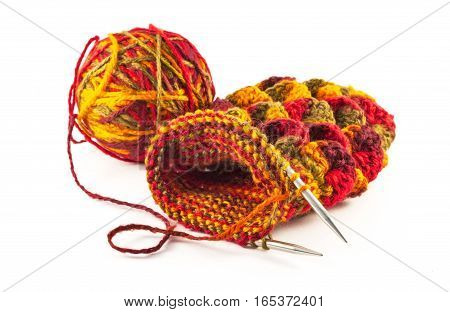 Crochet gloves with metal hooks and yarn ball on white background