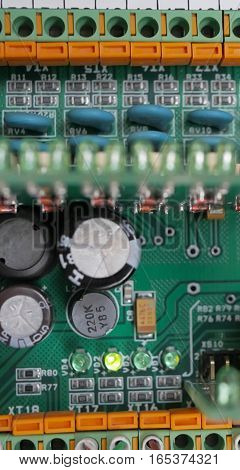 Electric board with electronic components close up