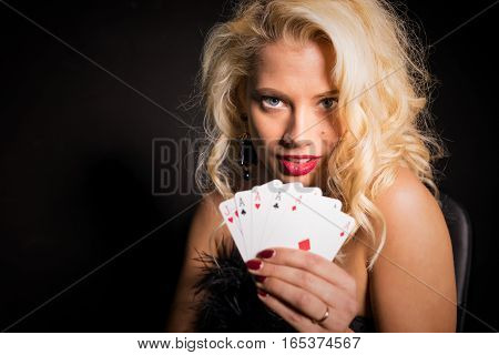 Sexy and beautiful woman showing her lucky deck