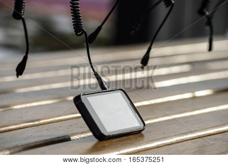 Smart cell phone on charge with many usb charging plugs