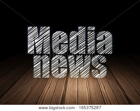 News concept: Glowing text Media News in grunge dark room with Wooden Floor, black background