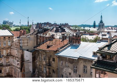 Town buildings and blue sky. Rooftops at daytime. Tour around the old district.