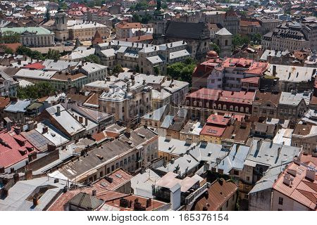 Buildings of town. Rooftops and sunlight. Townscape during daytime.