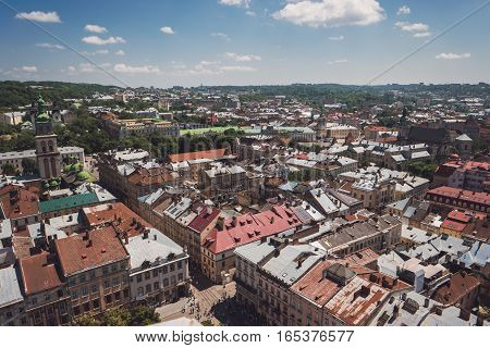 Town and cloudy sky. Aerial view of buildings. Old architecture and historic landmarks.