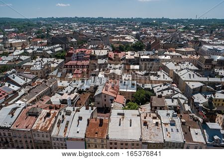 Sky and town at daytime. Rooftops and trees. Historic landmarks and old architecture.