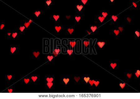 bokeh effect saint valentine's day hearts with black background
