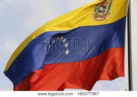the national venezuelan flag in the wind