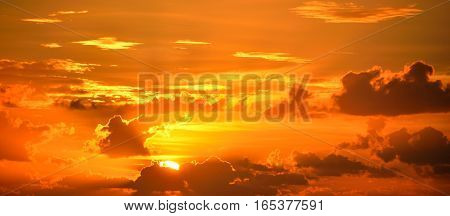 Vibrant orange color sunrise over the ocean horizon