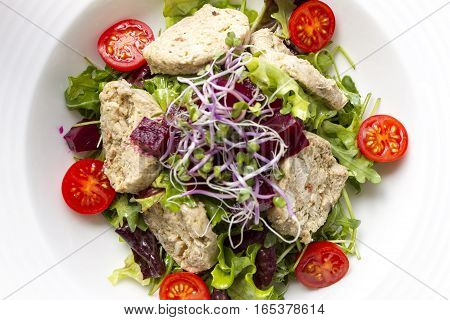 Fresh salad with cherry tomatoes beetroots and minced meat.