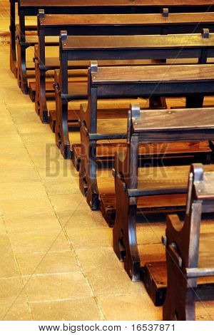 Row of wooden pews inside of a church poster