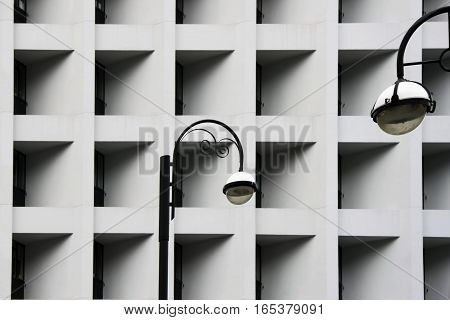 Street lamps against Modern abstract urban building. Detailed sharp, contrast geometric black and white pattern in city