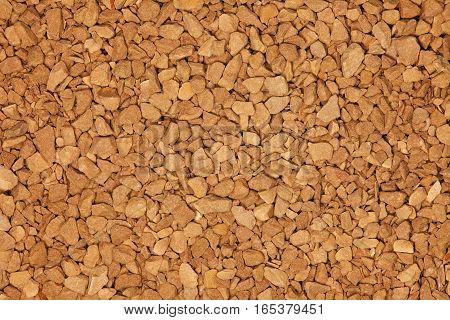 Instant coffee granules background up-close. Instant coffee details