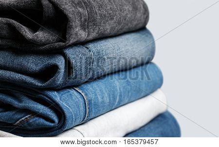 Stack of different jeans up-close. Low aperture shot selective focus
