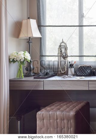 Dressing Room With Handbag; Sunglasses; Jewelry And Makeup Brushes On A Wooden Table
