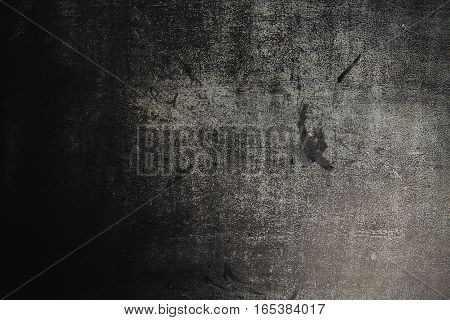 Texture of an old heavily used black dark gray slate chalk board