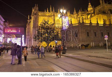 Seville Spain - January 2 2017: night view of the crowded avenida de la constitucion street on Christmas