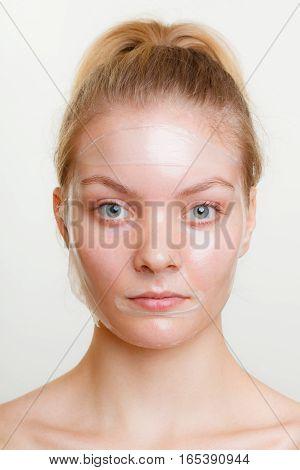 Woman In Facial Peel Off Mask.