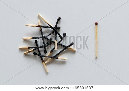 Pile of burnt matches and one unused.