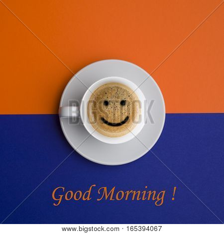 Good morning coffee cup over orange and blue background