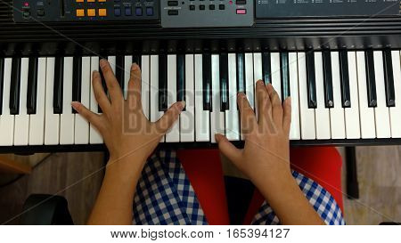 the hands of a musician plays keyboards.