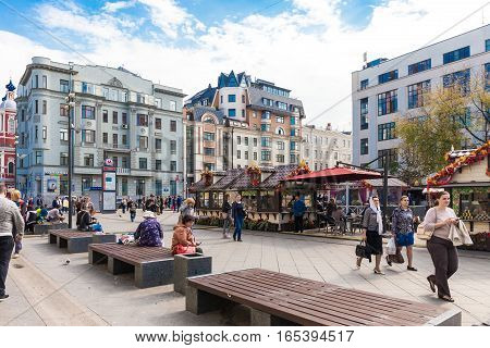 MOSCOW - SEPTEMBER 22 2015: People on the square near Tretyakovskaya metro station on Klimentovsky lane. The site was reconstructed and became pedestrian in 2013.