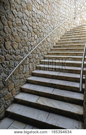 Flight of Stairs With Banister at Stone Wall