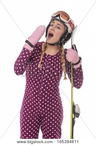 Yawning funny girl skier in night pajamas. Isolated on white.