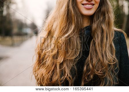 Smiling girl with long hair. Spring time