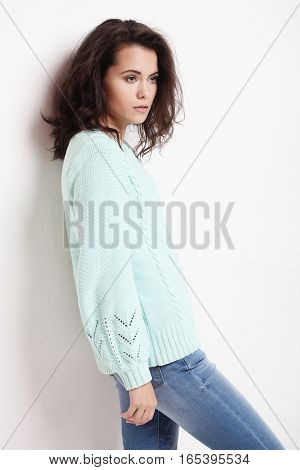 beautiful woman wearing casual clothes, posing on white background