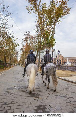 Seville Spain - January 3 2017: Mounted police at Plaza de Espana Seville Spain