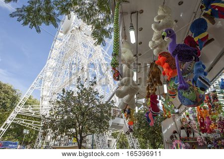 Seville Spain - January 3 2017: Christmas market with ferris wheel and raffle stall