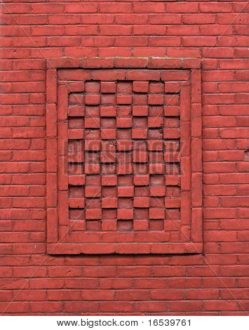 wall of old red bricks with  design feature of alternating depth end first checkerboard look