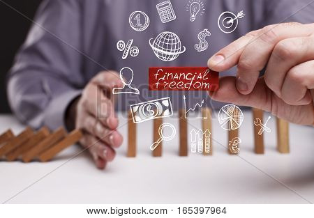 Business, Technology, Internet And Network Concept. Young Businessman Shows The Word: Financial Free