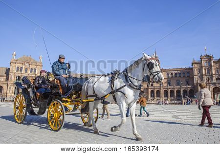 Seville Spain - June 24 2015: Horse drawn carriage in Plaza de Espana in Seville Andalusia Spain. Spain Square