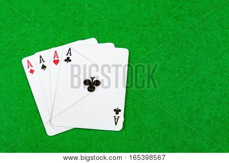 Four of a kind on a card table