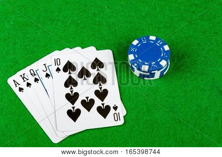 Royal flush poker hand with betting chips