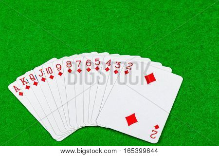 Full set of a suit on a card table