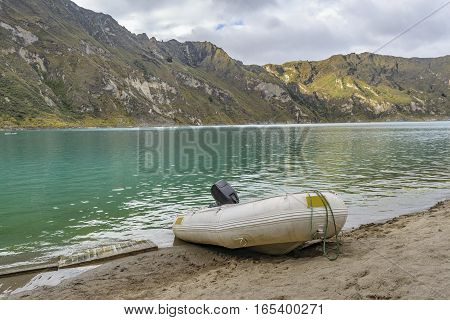 Quilotoa lake and andes range mountain against overcast cloudy background landscape scene Ecuador
