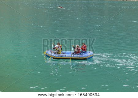 QUILOTOA, ECUADOR, FEBRAURY - 2016 - People rafting at quiet lake at Quilotoa volcano Latacunga Ecuador