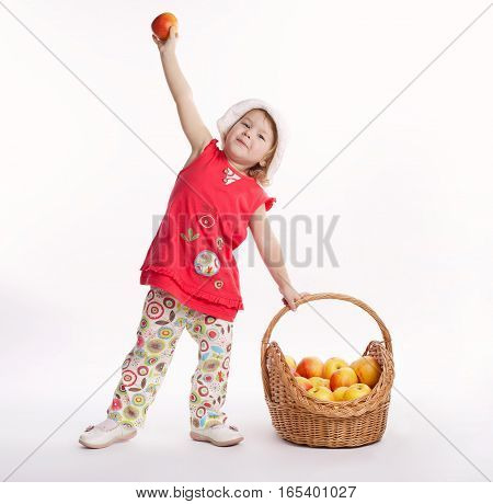 photo of cute little girl with apple and basket