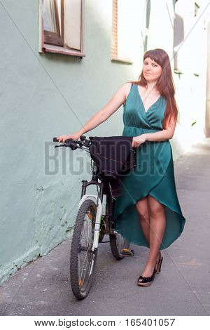 The perfect outfit! Advertising slogan: On ours bikes you can ride even in evening dress. Model pose for photograph