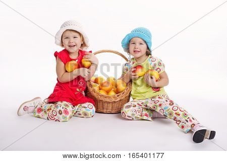 photo of two funny girls with apple harvest