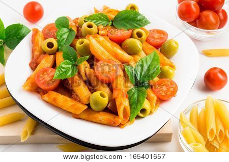 Plate Of Penne Pasta Decorated With Cherry Tomatoes