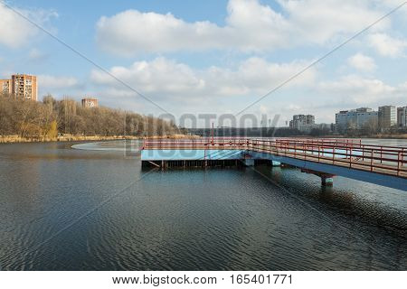 Concrete pier in winter time. Stock image.
