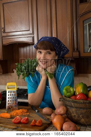 Woman cutting various vegetables in the kitchen