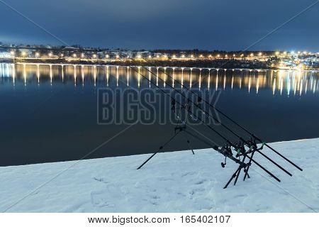 Carp Spinning Reel Angling Rods In Winter Night. Night Fishing