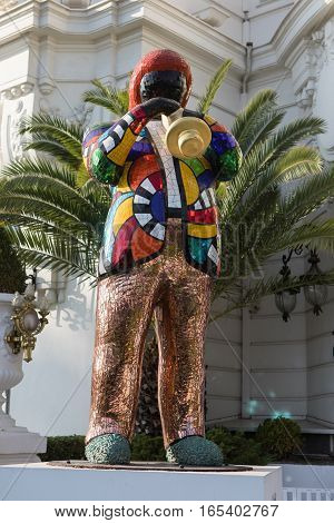 Nice France - November 3 2016: Statue of Miles Davis by French sculptor painter and film maker Niki de Saint Phalle 1999 set in front of famous and luxury hotel Negresco.