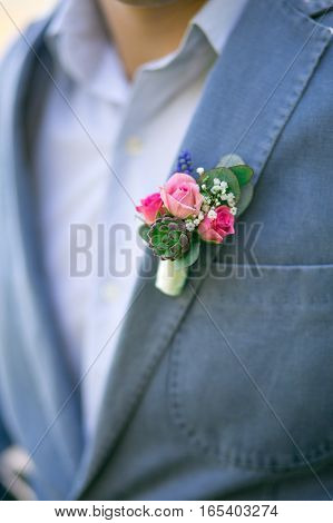 Handsome Groom In A Wedding Suit With A Boutonniere