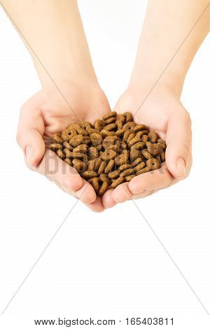 Hands Full Of Dry Cat Food On White Background