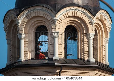 Vilnius Lithuania - October 1 2016: Bell-ringer in the belfry of Our Lady of the Sign Church the orthodox church in Vilnius Lithuania.